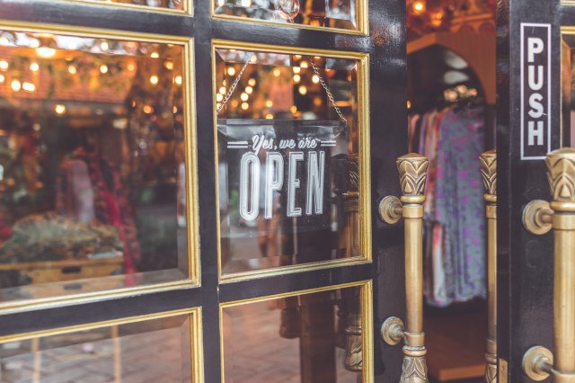 Front door to store with an open sign
